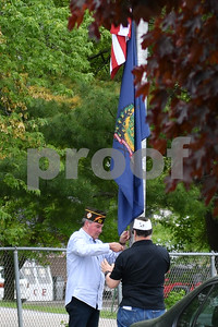 Tom Holland, left, Jr. Vice Commander and John Pisanelli, Quartermaster, of Rutland's Post 648 participate in the Lowering of the Flag at Rutland High School during the Memorial Day Ceremony. (Robert Layman / Staff Photo)