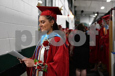 Senior Class Honor Speaker Sophia Moore-Smith rehearses her speech moments before the Rutland High School class of 2018 graduation at Spartan Arena Thursday night. (Robert Layman / Staff Photo)