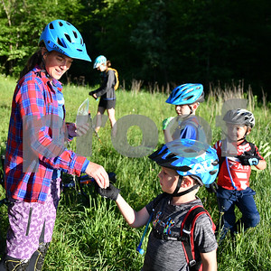 As a treat Bettina Davis, Climb Master, left,  awards the children with one gummy bear. (Robert Layman / Staff Photo)