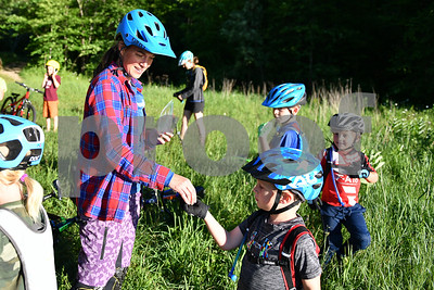 As a treat Bettina Davis, Climb Master, left,  awards the children with one gummy bear. (Robert Layman / Staff Photo)