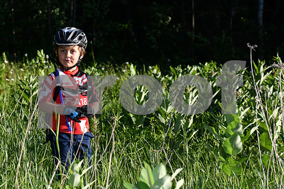 Wilder DiDomenico, 4, soaks up the sunlight in a patch of milkweed. (Robert Layman / Staff Photo)