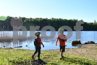 Children enjoy a nice view of Rocky Pond. (Robert Layman / Staff Photo)