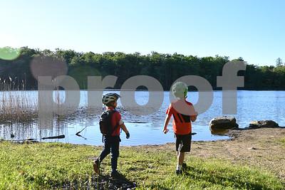 Children enjoy a nice view of Rocky Pond. (Robert Layman / Staff Photo)
