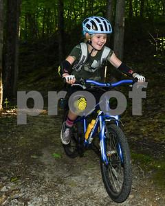 Wren Williamson, 8, smiles as she decends a hill. (Robert Layman  / Staff Photo)