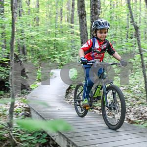 Wilder DiDomenico, 4, pushes hard up a hill. (Robert Layman / Staff Photo)