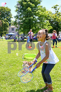 Veronica Wilson, 4, of Rutland, right, plays badminton with her grandmother Tammy, not pictured, during the Rutland Summer Meals Kick Off in Main Street Park in Rutland Tuesday afternoon. (Robert Layman / Staff Photo)