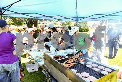 Ruth Reich, who serves as the Program Coordinator, for the Boys and Girls Club in Fair Haven, cooks up food for the Rutland Summer Meals Kick Off in Main Street Park in Rutland Tuesday afternoon. (Robert Layman / Staff Photo)