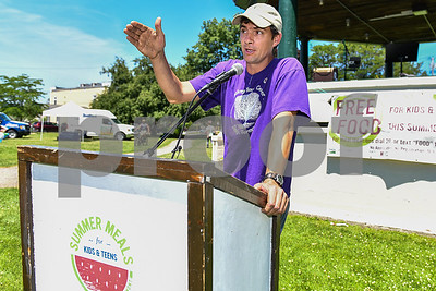Jesse Pyles, executive Director of the Smokey House Center in Danby, speaks at the Summer Meals for Kids & Teens event at Main Street Park in Rutland. (Robert Layman / Staff Photo)