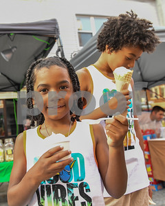 Dante Anderson, 6, and his brother Dominic, 10, right, enjoy maple cremees during the Friday Night Live Celebration. (Robert Layman / Staff Photo)