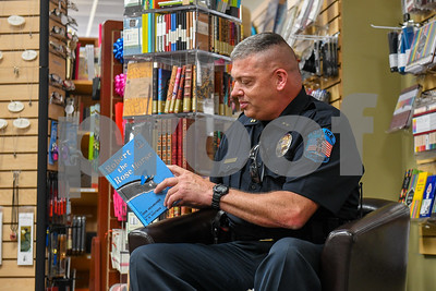 "Rutland City Police Cheif Brian Kilcullen prepares to read ""Robert the Horse,"" Joan Heilbroner and P.D. Eastman. The horse finds many jobs in the story, from mail worker to ending as police officer, who saves the day. (Robert Layman / Staff Photo)"