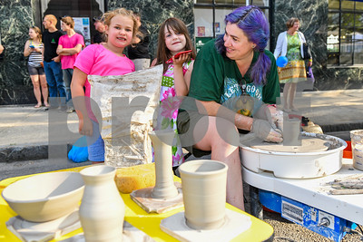 Helvi Abatiell, right, works the pottery wheel while her daughter Dessa Abatiell, 6, pose for a picture. (Robert Layman / Staff Photo)
