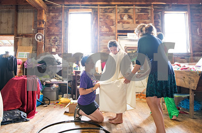 "Rainbow Squier, director at Theater in the Woods, helps Mrs. Humpty Dumpty, center, played by Gemma Snook, center, dress for a costume parade. On the right is Emma Luikart, who is playing  Mr. Humpty Dumpty. The camp, which is based in Middletown Springs will perform ""Humpty Dumpty's Dream,"" a play written by Frank Asch, at the camp off of Orchard Road in Middletown Springs Friday at 2:30. (Robert Layman / Staff Photo)"