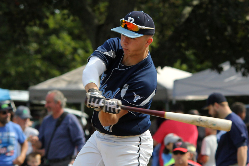 Peabody, Ma.9-4-17.  Jake Gustin, a senior at Peabody High School, played for the old timers at the 61st annual Peabody and Lynnfield charity baseball game played at Emerson Park in Peabody to raise money for cancer research.
