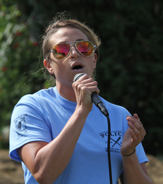 Peabody, Ma. 9-4-17. Cortney Penta sang the National Anthem at the beginnilng of the 61st annual Peabody and Lynnfield charity baseball game at Emerson Park in Peabody held to raise money for cancer fresearch.