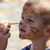 Peabody, Ma. 9-4-17. Jackson Fagundes having his face painted as a tiger at the 61st annual Peabody and Lynnfield Charity Baseball game at Emmerson Park in Peabody to raise money for cancer research. .