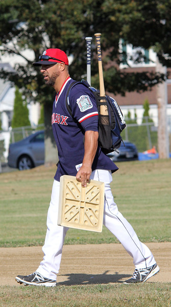 Peabody, Ma. 9-4-17. Steve Lomasney not only played in the game, he brought the bases to the 61st annual Peabody and Lynnfield charity baseball game played at Emerson Park in Peabody to rasie money for cancer research.