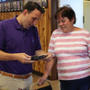 Revere, Ma. 7-30-17. Revere Mayor Brian Arrigo,left,getting a gift of a picture of him and John Fraugten, a fire victim and her her grandson,that was taken when he and John went out to lunch together. .