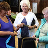 Revere, Ma. 7-30-17. Laura Evans, left, of the Revere Elks Club, selling 50/50 raffle tickets to Kathleen Heiser and Nancy Dowd at the fundraiser for the victims of the fire on Taft Street in Revere.