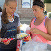 Peabody, Ma. 8-13-17. Jordyn Collins and Madelyne Lomasney giving out pop corn at the Mayor's Picnic.