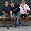 Lynn, ma. 8-9-17. Mike Ciella, left, Dom Finelli, middle, and Eugene Doherty playing boccie at the Italian American Citizens Club on Harbor Street in Lynn.