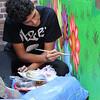 Lynn, Ma. 8-9-17. Austin Jagodynski, a member of RAW Art Works, working on mural at Zabota Adult Day Health in Lynn.