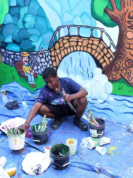 Lynn, Ma. 8-9-17. Kesnel Dabel working on the mural at Zabota Adult Day Health on Exchange Street in Lynn.