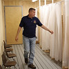 Middleton, Ma. 6-27-17. Christopher Galatis of Local 26 Carpenters Union looking over the boys side of the new changing room that members of his union built at Camp Creighton Pond in Middleton as a charity project.