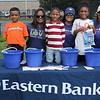 Lynn, Ma. 8-27-17. Joniel Guerrero, Alba Caro, Aarmania Perez, Adrianan Moschella, Jasmine Perez, and Johanna Tejada were on hand from Eastern Bank at the first Sporting and Recreational Fair amigos de la Voz at McManus Field.