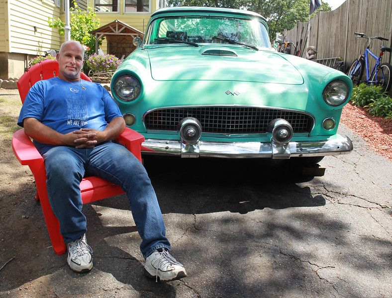 Lynn, MA--Mon July 10--Guy Moley of Lynn and his family are having a car show on July 16 at Fuddruckers in Saugus to raise money for the American Cancer Society. The car  he's sitting next to is a replica of a 1955 Ford Thunderbird. <br /> <br /> Daily Item Staff photo/Jim Wilson