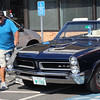 Saugus, Ma. 7-16-17. Keith Barnes dusts his 1965 GTO at Mom's Cancer Fighting Angels antique car show at Fuddruckers in Saugus on Sunday.
