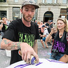 Artist Brand Rockwell tags a ballon during Rock the Block on Saturday.