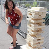 Lynn, Ma. 7-4-17. Crystal Smith playing Jenga at the block party on Ontario Street in Lynn.
