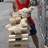 Lynn, Ma. 7-4-17. Lloyd Nolan loses a game of Jenga at the Ontario Street block party.
