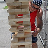 Lynn, Ma. 7-4-17. Lloyd Nolan is about to lose a game of Jenga at the Ontario Street block party.