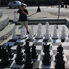 Revere, Ma. 6-12-17. Amya Conn checks out the chess set in front of Revere City Hall.