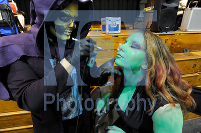 Jeb Wallace-Brodeur / Staff Photo Katie Mullins of Milton, dressed as Gamora from Guardians of the Galaxy, receives a coating of airbrush make-up from Sean Avram of h8ine4sburg who owns The Awesome Shop, a custom airbrush parlor in South Burllington at the Green Mountain Comic Expo at the Barre Auditorium on Saturday. The event continues Sunday from 10 a.m. to 5 p.m.