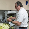 Michael Cucchiello Sr. slices eggplants to prepare for making eggplant parmesan at Cucchiello's Bakery in Saugus.