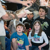 Kids look on while Corey Kummel of Curious Creatures shows of the teeth of a north american alligator at Lynn Museum on Tuesday.