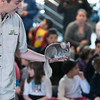 Corey Kummel of Curious Creatures holds up a chinchilla for the crowd of kids and adults at Lynn Museum on Tuesday.