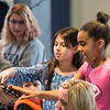 Left, Valeria Valencia, 10, of Lynn and Richelly Maria, 10, of Lynn touch a carpet python during the Curious Creatures presentation at Lynn Museum on Tuesday.