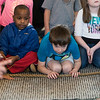 Kids watch as a carpet python slithers toward them during the Curious Creatures presentation at Lynn Museum on Tuesday.