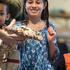 Valeria Valencia, 10, of Lynn pets a tegu lizard during the Curious Creatures presentation at Lynn Museum on Tuesday.