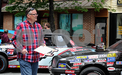 Robert Layman / Staff Photo Rutland City Mayor Dave Allaire thought his afternoon was going to a pleasant stroll through Center Street looking at the Downtown Devil's Bowl car show until he was handed a clip board and asked to help judge.