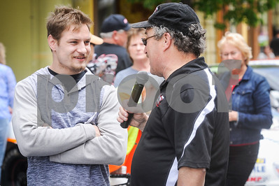 Robert Layman / Staff Photo Announcer talks with Joey Scarborough.