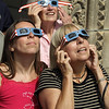 Nahant, MA Mon Aug 21, 2017- [front l-r] Margaret Alexander, Christine Alexander and [top rear] Winnie Hodges all from Nahant. Viewing the eclipse at the steps of the Nahant Library.<br /> <br /> Item Staff Photo/Jim Wilson