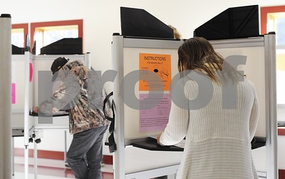 Robert Layman / Staff Photo  Voters cast their ballot at the Castleton Fire Department Tuesday Morning during the general election.