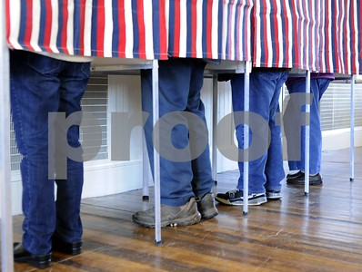 Robert Layman / Staff Photo  Voters stand in a shielded American flag booth at the West Rutland town hall during the General Election Tuesday morning.