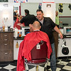 George's Barber Shop owner Mike Moriello cuts the hair of Tony Pascuccio of Middleton during the shop's first day open after undergoing renovations.