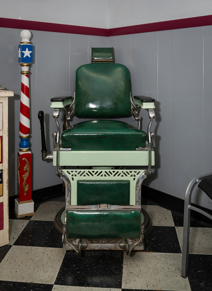 An antique barber's chair sits in the corner of George's Barber Shop in Saugus.