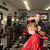 Four-year-old Bruno Hubbard of Saugus gets his hair cut by George's Barber Shop owner Mike Moriello.